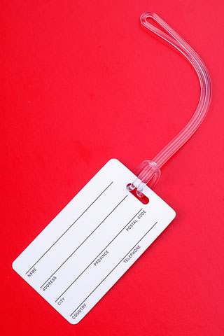 luggage tag label on a red background